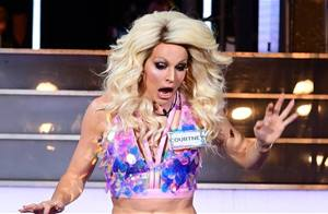 Watch Courtney Act skirt sashay away!