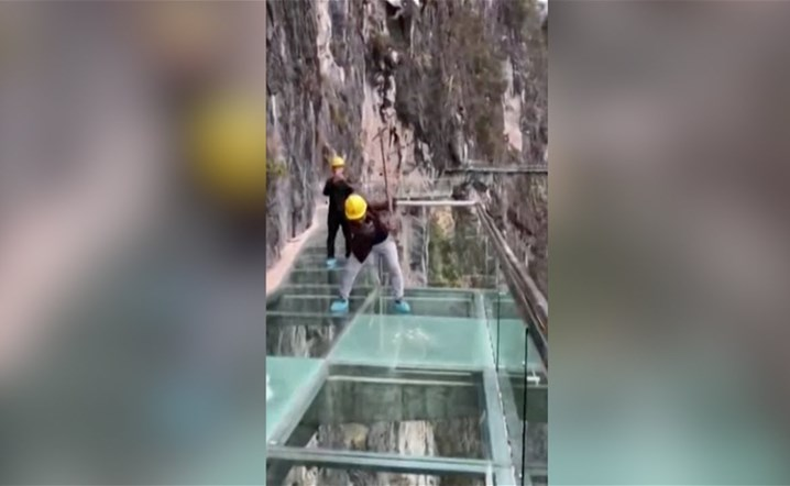 Workers hit dizzyingly high glass walkway with sledgehammers