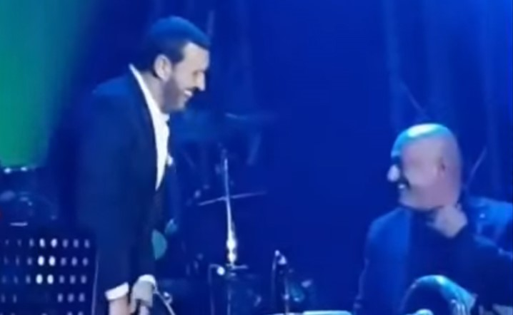 Kazem Al Saher playing the drums skillfully
